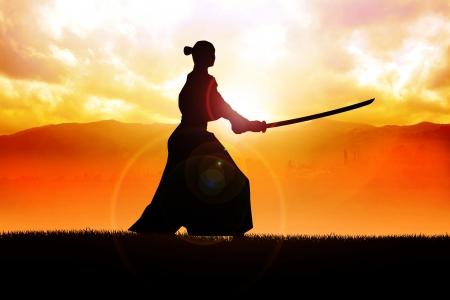 Silhouette of a samurai posing during sunset
