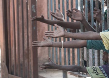 Foto de Poor people and human poverty concept - person hands begging for food or help - Imagen libre de derechos