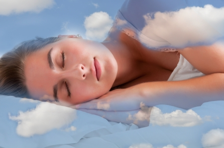 Foto de Woman sleeping in the clouds and dreaming - Imagen libre de derechos