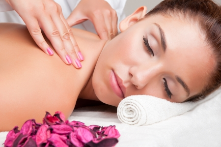 Young woman lying in a spa ready to get a massage