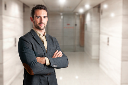 Photo for Casual business man with arms crossed in a white background - Royalty Free Image