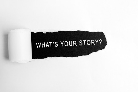 Foto de What your story? words on torn paper - Imagen libre de derechos