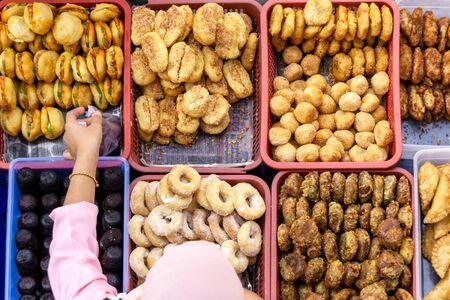 Foto de Top view of unidentified vendor and customer at the food stall in Kota Kinabalu city food market. - Imagen libre de derechos