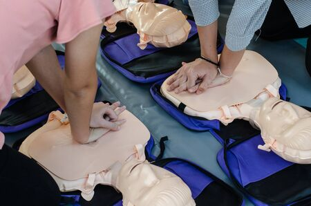Foto de CPR training chest compressions for first aid  in emergency.  - Imagen libre de derechos