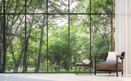 Photo pour Modern living room with garden view 3d rendering Image.There are large window overlooking the surrounding garden and nature - image libre de droit