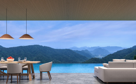 Foto de Loft style pool villa living and dining room with mountain view 3d rendering image.The room has polished concrete floor,wood lattice ceiling.Looking out to the mountains view. - Imagen libre de derechos