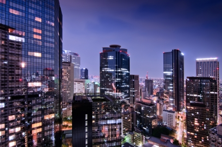 Photo for Tokyo s glassy skyscrapers at night - Royalty Free Image