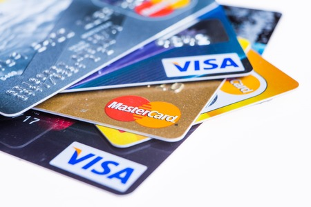 Photo pour Samara, Russia- 3 February 2015: Closeup studio shot of credit cards issued by the three major brands American Express, VISA and MasterCard. - image libre de droit