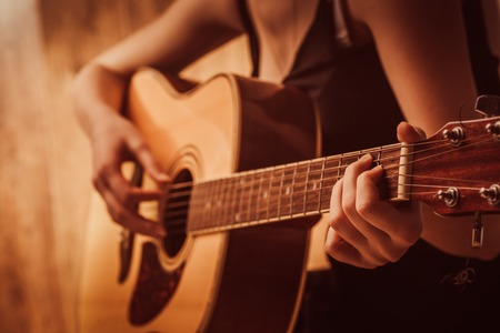 Photo for woman's hands playing  acoustic guitar, close up - Royalty Free Image