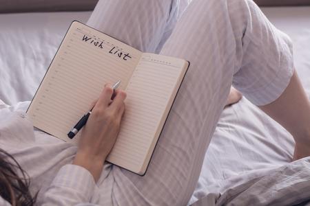 Foto de Cropped image of a woman in pajamas lying in bed and is a piece of desire.rear view - Imagen libre de derechos