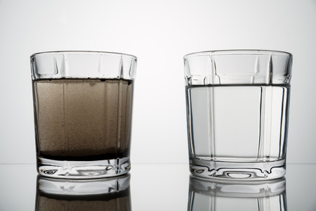 Foto de close up glasses with clean and dirty water. concept of water pollution - Imagen libre de derechos
