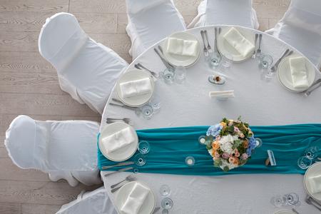 Photo pour Elegance table set up for wedding in turquoise top view - image libre de droit
