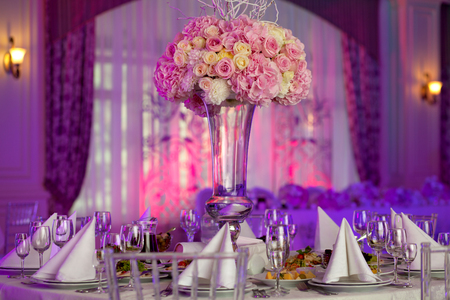 Photo for Table setting at a luxury wedding reception. Beautiful flowers on the table. - Royalty Free Image