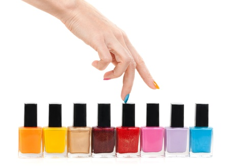 Female hand fingers are the colored paints polish isolate on a white background