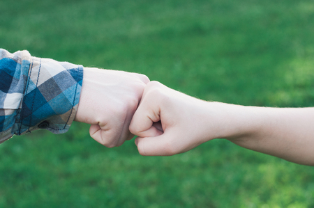 Photo for Teenagers giving fist bump at meeting - Royalty Free Image