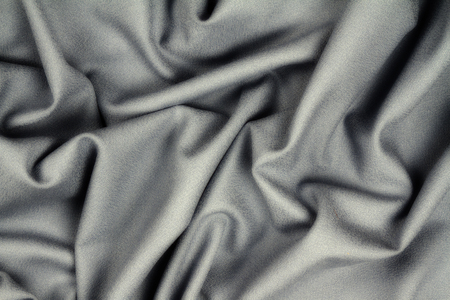 Photo for Gray woolen crumpled wrinkled fabric with waves, background crumpled tissue  - Royalty Free Image