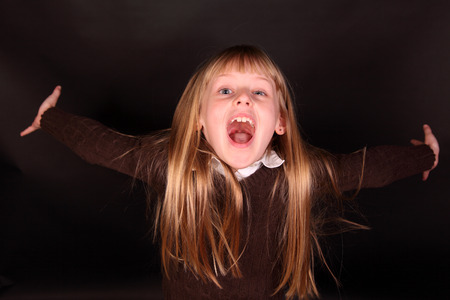 Photo for little girl shouts with happiness joy - Royalty Free Image