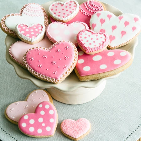 Photo for Cake stand filled with Valentine cookies - Royalty Free Image