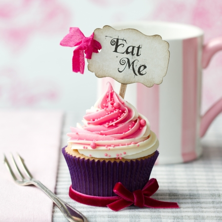 Photo for Cupcake with Eat Me pick - Royalty Free Image