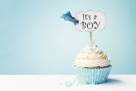 Photo for Baby shower cupcake with copy space to side - Royalty Free Image
