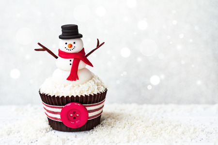 Photo for Snowman cupcake with copyspace to side - Royalty Free Image