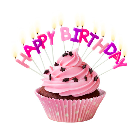 Photo for Pink cupcake decorated with birthday candles - Royalty Free Image