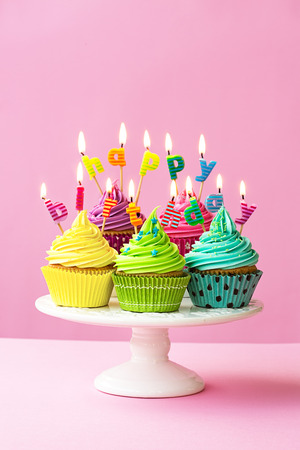 Photo for Happy birthday cupcakes on a cakestand - Royalty Free Image