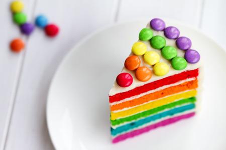 Foto de Colorful slice of rainbow layer cake - Imagen libre de derechos