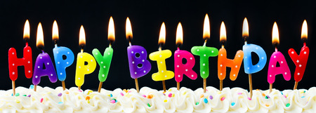 Photo for Happy birthday candles against a black background - Royalty Free Image