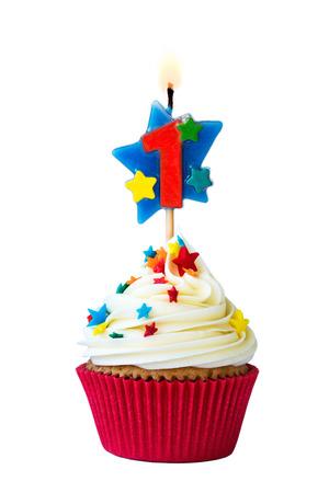 Foto de Cupcake with number one candle - Imagen libre de derechos