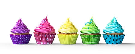 Photo pour Row of colorful cupcakes isolated on a white background - image libre de droit