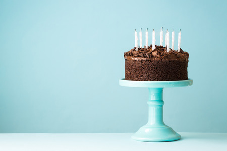 Photo for Chocolate birthday cake with blown out candles - Royalty Free Image