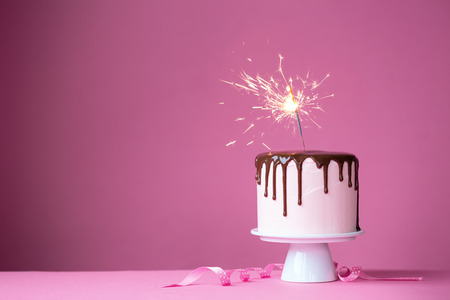 Photo for Cake decorated with a sparkler - Royalty Free Image