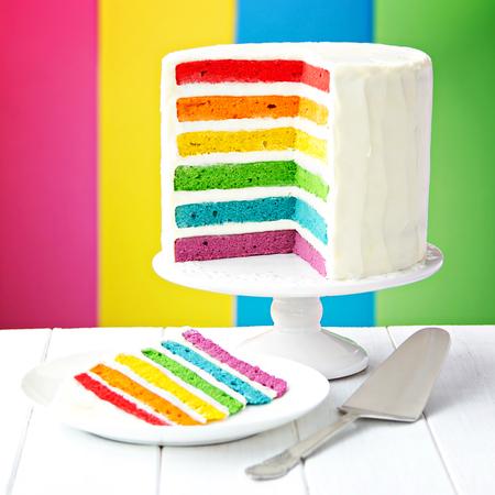 Photo pour Rainbow layer cake on a cake stand - image libre de droit
