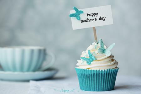 Photo for Mother's day cupcake with copy space to side - Royalty Free Image