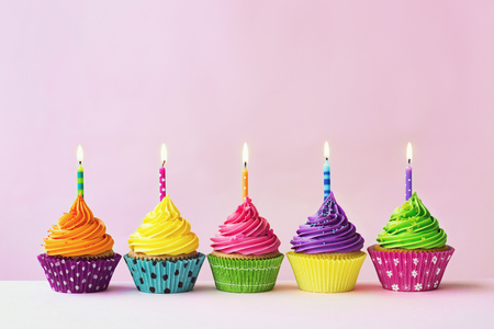 Photo for Row of colorful birthday cupcakes - Royalty Free Image