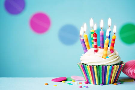 Photo for Colorful birthday cupcake with single candle - Royalty Free Image
