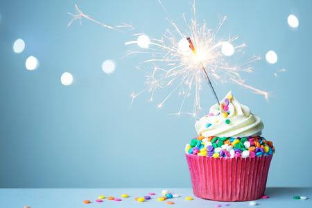 Foto de Colorful cupcake with sparkler - Imagen libre de derechos