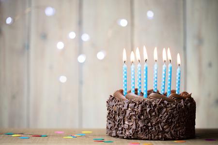 Foto de Birthday cake with blue candles - Imagen libre de derechos