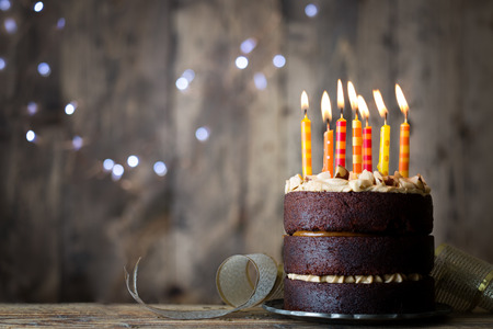 Photo for Chocolate birthday cake with candles - Royalty Free Image