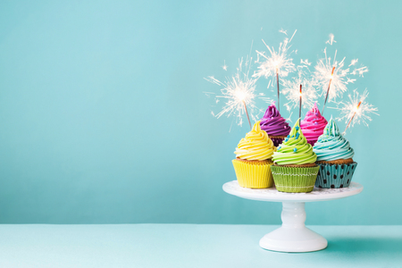 Photo for Cupcakes on a cake stand with sparklers - Royalty Free Image