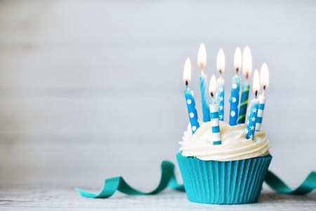 Photo for Cupcake with blue birthday candles - Royalty Free Image