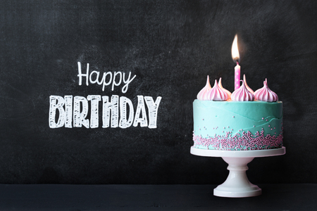 Photo for Birthday cupcake in front of a chalkboard - Royalty Free Image