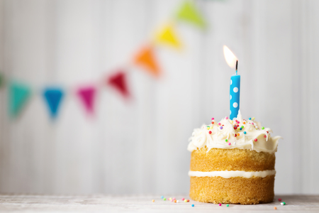 Photo for Mini birthday cake with a single candle - Royalty Free Image
