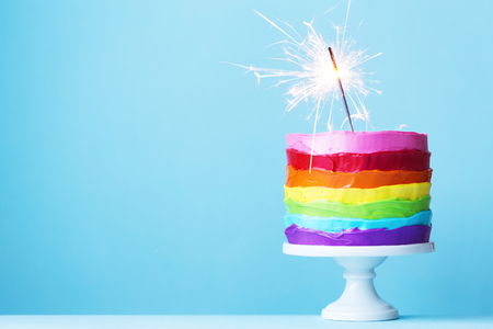 Photo for Rainbow cake with sparkler - Royalty Free Image
