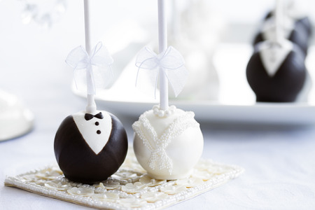 Photo for Bride and groom cake pops - Royalty Free Image