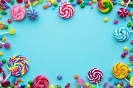 Photo for Colorful candies on a blue background - Royalty Free Image