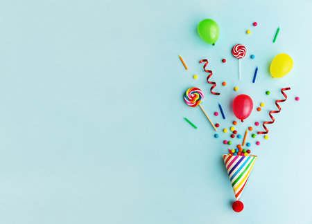 Photo for Party hat with candy, balloons and birthday candles - Royalty Free Image
