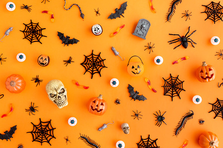 Photo pour Orange background with collection of Halloween objects overhead view - image libre de droit