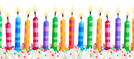 Photo for Brightly colored birthday cake candles against a white background - Royalty Free Image